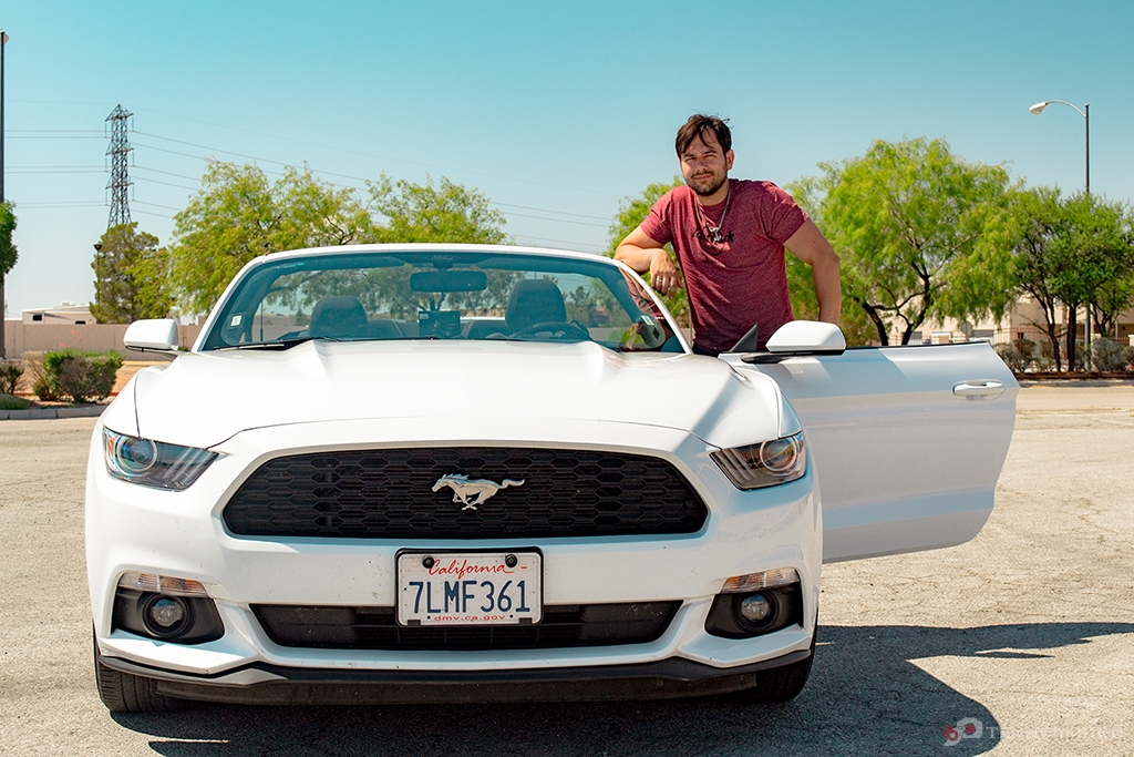 Hendrik and the white Mustang Cabrio