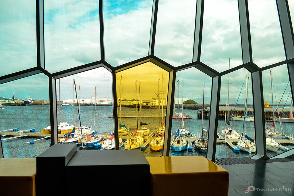 A yellow window in the National Music Conference Center Iceland