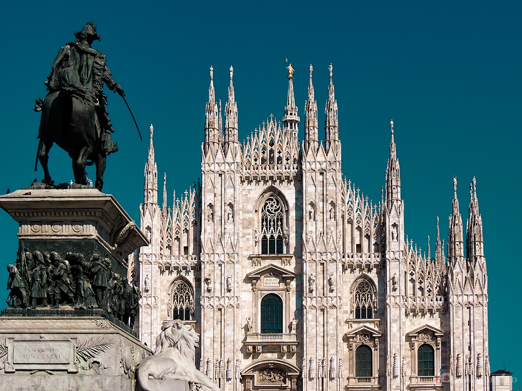 The Cathedral of Milano and Statue